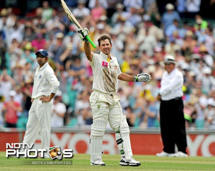 Ricky Ponting waves his bat after reaching his 100 on Day 2 of the second Test against India at the Sydney Ground. (AFP Photo)