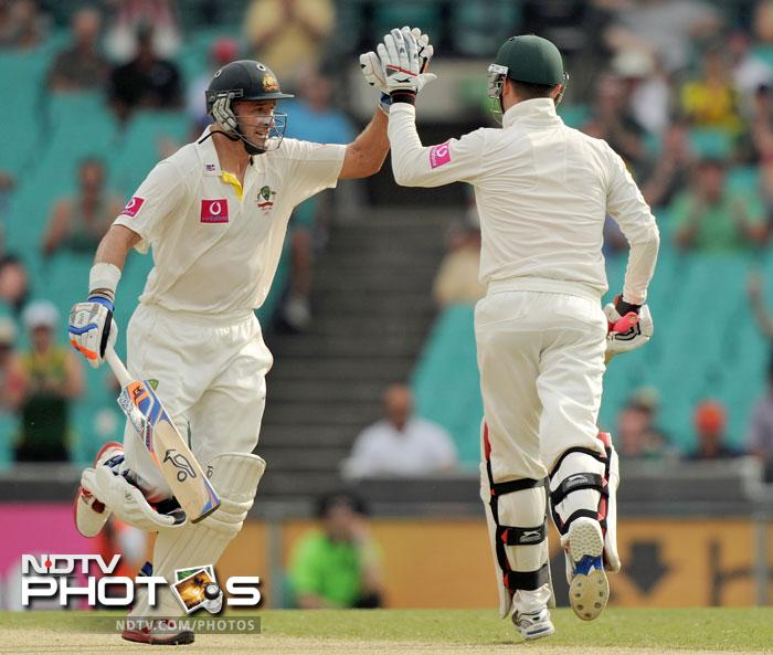Michael Clarke is congratulated by Michael Hussey after reaching his 250 on Day 2 of the second Test against India at the Sydney Ground. (AFP Photo)