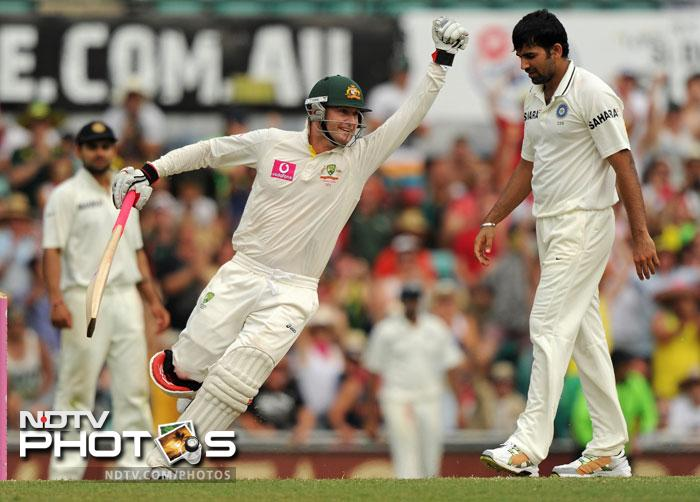 Michael Clarke celebrates after scoring 200 on Day 2 of the second Test against India at the Sydney Ground. (AFP Photo)