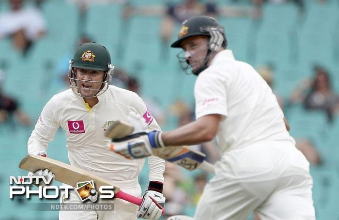 Michael Clarke and Mike Hussey run between the wicket on Day 2 of the second Test match against India at the SCG in Sydney. (AP Photo)
