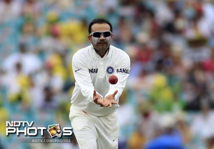 Virender Sehwag catches the ball while playing Australia on Day 2 in their second Test match at the Sydney Ground in Sydney. (AP Photo)
