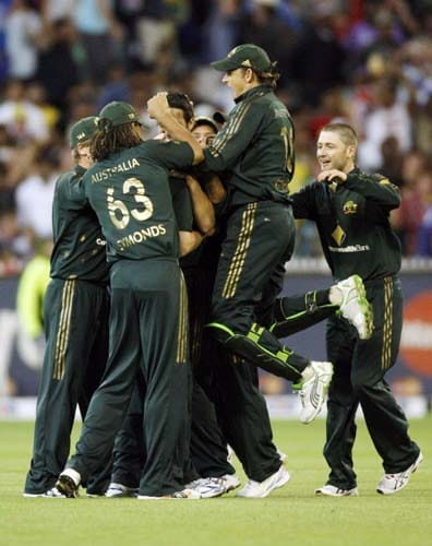 Australian players celebrate the wicket of India's Sachin Tendulker during their one-day international cricket match at the Melbourne Cricket Ground on Sunday, February 10, 2008.