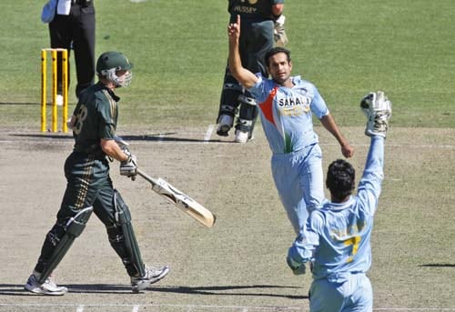 Irfan Pathan, center, and MS Dhoni celebrate the wicket of Brett Lee, left, from Australia during their one-day international cricket match at the Melbourne Cricket Ground on Sunday, February 10, 2008.