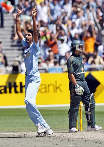 Ishant Sharma, left, celebrates the wicket of Ricky Ponting from Australia during their one-day international cricket match at the Melbourne Cricket Ground on Sunday, February 10, 2008.