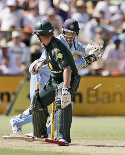 James Hopes, left, drops his bat as he turns to see he is stumped by Mahendra Dhoni in their one-day international cricket match at the Adelaide Oval on Sunday, February 17, 2008.