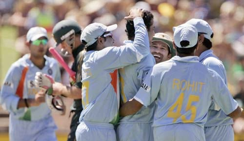 Indian team mates congratulate Irfan Pathan, 4th right, after he took the wicket of Matthew Hayden, second left, for 13 runs in their one-day international cricket match at the Adelaide Oval on Sunday February 17, 2008.