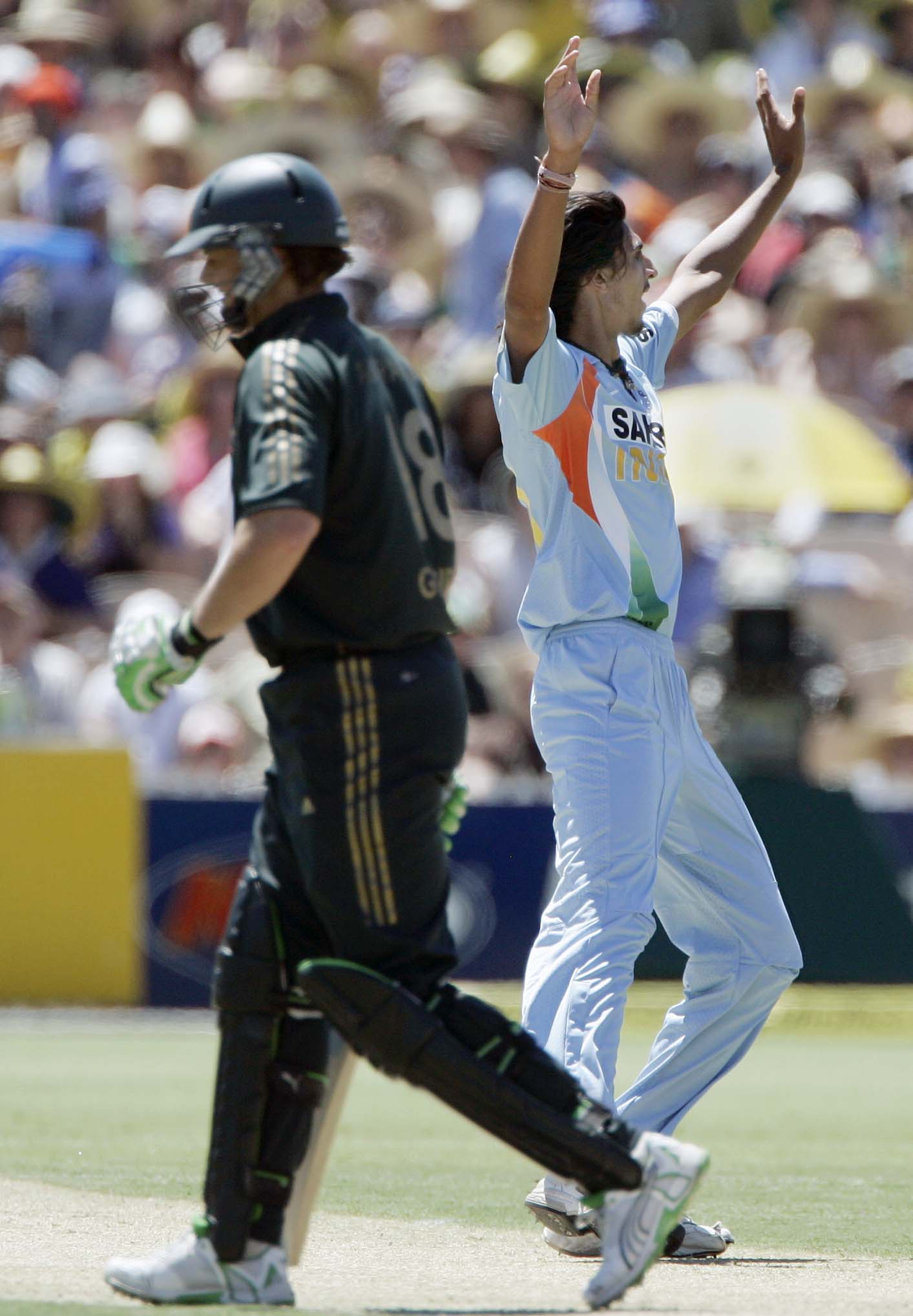 Ishant Sharma, right, celebrates bowling out Adam Gilchrist, left, for 15 runs in their one-day international cricket match at the Adelaide Oval on Sunday, February 17, 2008.