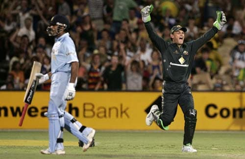 Adam Gilchrist, right, celebrates after he caught out Robin Uthappa, left, for 18 runs in their one-day international cricket match at the Adelaide Oval on Sunday, February 17, 2008. Australia made 203 in their innings.