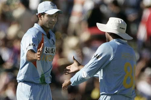 Harbhajan Singh, right, shakes hands with teammate Irfan Pathan after Pathan took 4 wickets against Australia in their one-day international cricket match at the Adelaide Oval on Sunday, February 17, 2008. Australia made 203 in their innings.