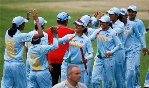 Indian team members celebrate after their win over Australia's in their Women's World Cup cricket match at North Sydney Oval in Sydney on Saturday, March 14, 2009. India won by 16 runs (AP Photo)
