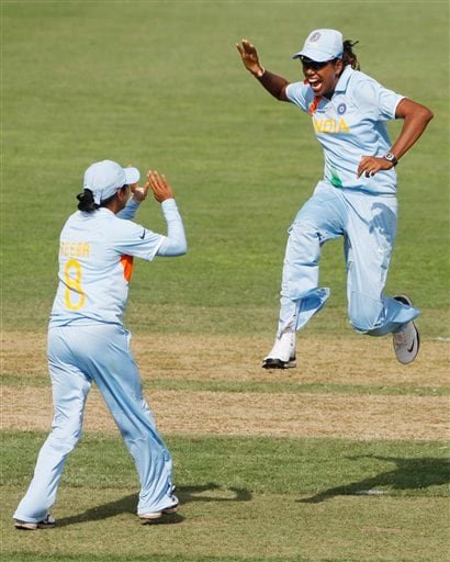 Reema Malhotra, left, celebrates with teammate Jhulan Goswami, right, after taking a wicket during their Women's World Cup cricket match against Australia at North Sydney Oval in Sydney on Saturday, March 14, 2009.(AP Photo)