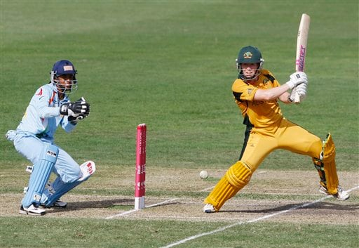 Australia's Alex Blackwell in action as Indian wicketkeeper Anagha Deshpande left, looks on during their Women's World Cup cricket match at North Sydney Oval in Sydney on Saturday, March 14, 2009.(AP Photo)