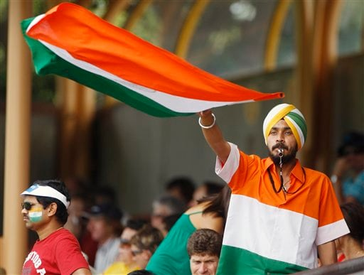 An Indian cricket fan cheers on the Indian women's cricket team during their Women's World Cup cricket match against Australia at North Sydney Oval in Sydney on Saturday, March 14, 2009. (AP Photo)