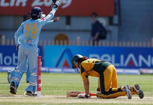 Australia's Karen Rolton, right, is given out stumped by India's Anagha Deshpande, left, during their Women's World Cup cricket match at North Sydney Oval on Saturday, March 14, 2009. (AP Photo)