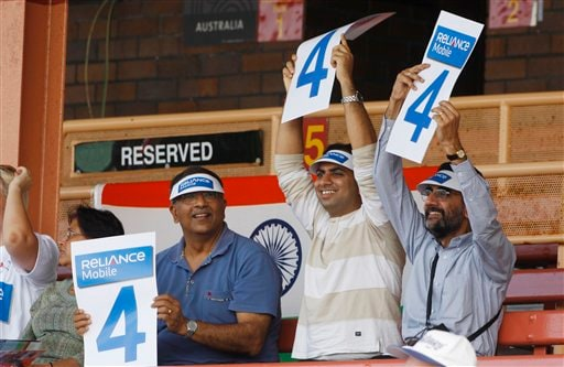 Indian cricket fans hold up score cards during their Women's World Cup cricket match between India and Australia at North Sydney Oval.(AP Photo)