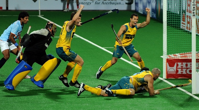 Australian hockey player Glenn Turner scores a goal against India during their World Cup 2010 match at the Major Dhyan Chand Stadium in New Delhi. (AFP Photo)