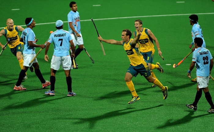 Australian hockey player Liam De Young reacts after scoring a goal against India during their World Cup 2010 match at the Major Dhyan Chand Stadium in New Delhi. (AFP Photo)