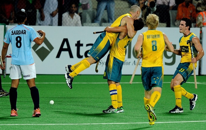 Australian hockey player Glenn Turner celebrates with teammates after scoring the team's fifth goal against India during their World Cup 2010 match at the Major Dhyan Chand Stadium in New Delhi. (AFP Photo)