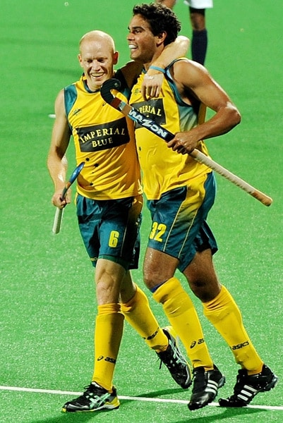 Australian hockey players Robert Hammond (L) and Desmond Abbott celebrate a goal against India during their World Cup 2010 match at the Major Dhyan Chand Stadium in New Delhi. (AFP Photo)