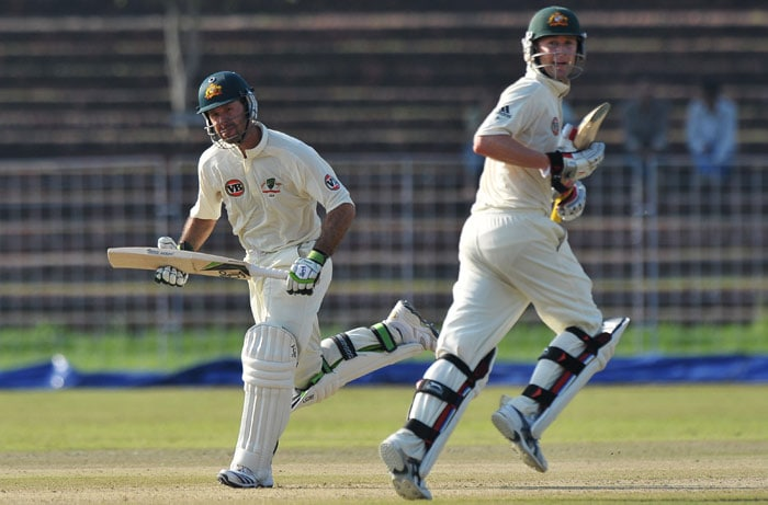 Ricky Ponting and Michael Clarke run between wickets during the first day of the three-day practice match against the Indian Board President's XI in Chandigarh. (AFP Photo)