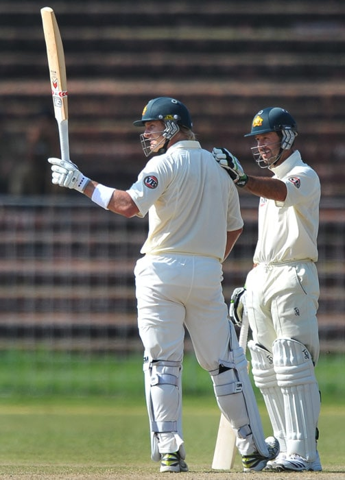 Ricky Ponting congratulates teammate Shane Watson for scoring a century during the first day of the three-day practice match against the Indian Board President's XI in Chandigarh. (AFP Photo