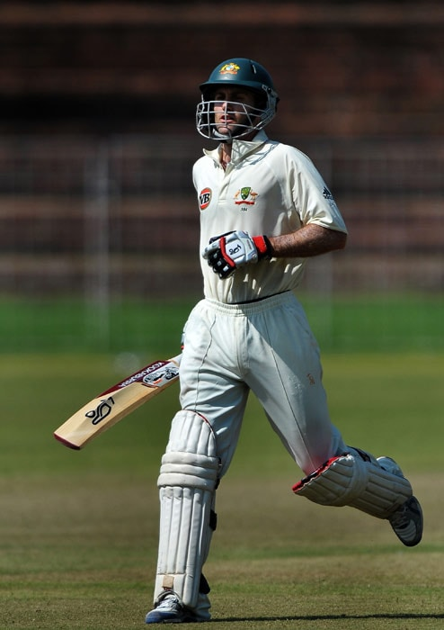 Simon Katich completes a run to make his century (100 runs) during the first day of the three-day practice match against the Indian Board President's XI in Chandigarh. (AFP Photo)