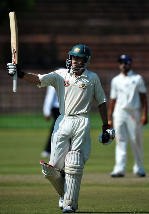Simon Katich celebrates after scoring a century (100 runs) during the first day of the three-day practice match against the Indian Board President's XI in Chandigarh. (AFP Photo)