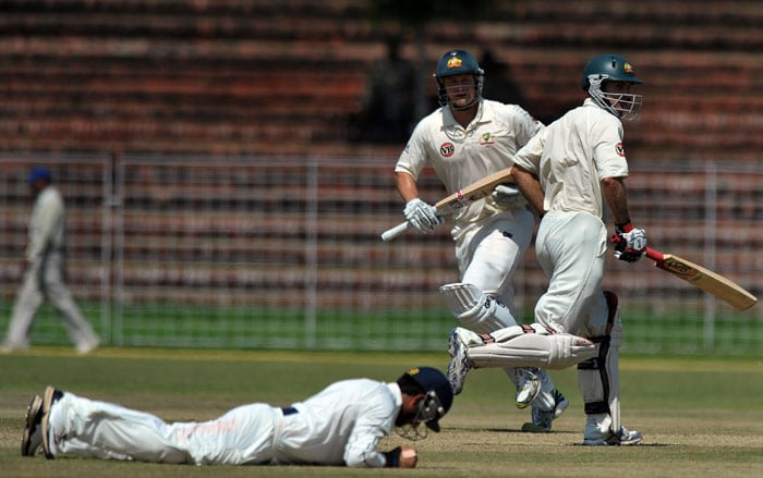 Shane Watson and Simon Katich run between wickets during the first day of the three-day practice match against the Indian Board President's XI in Chandigarh. (AFP Photo)