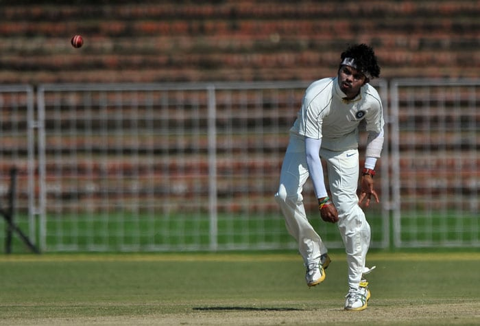 Santhakumaran Sreesanth bowls during the first day of the three-day practice match against the Indian Board President's XI in Chandigarh. (AFP Photo)