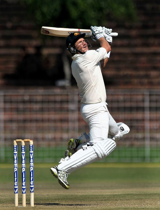 Shane Watson plays a shot during the first day of the three-day practice match against the Indian Board President's XI in Chandigarh. (AFP Photo)