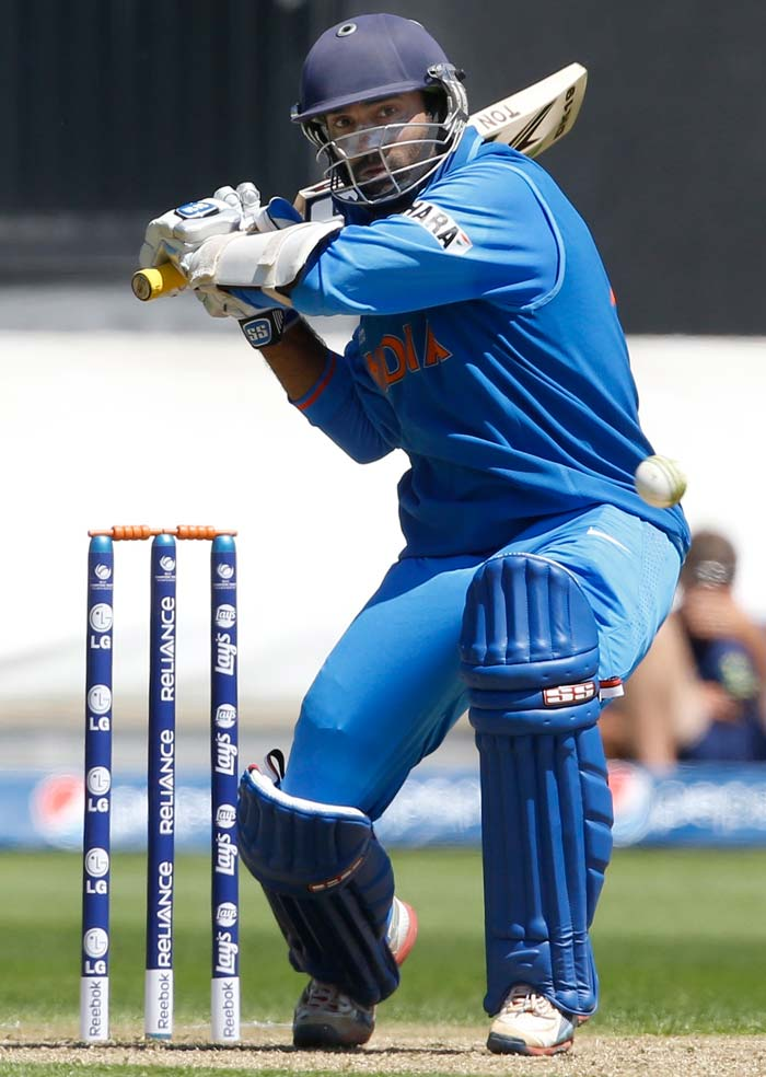 Dinesh Karthik played cautiously in the beginning, setting up a partnership with skipper MS Dhoni.