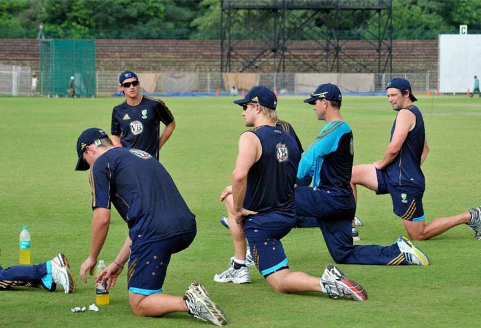 Australian players indulge in some stretching exercise ahead of their practice match which is under threat of being rained out. (PTI Photo)