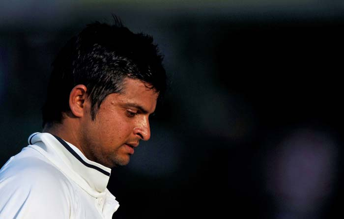 Suresh Raina walks back to the dressing room after losing his wicket during the third day of the first Test between India and Australia in Mohali. (AFP Photo)