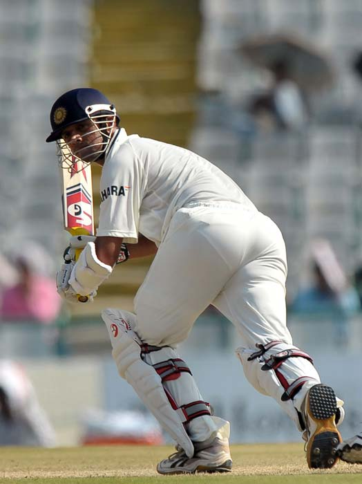 Rahul Dravid plays a shot during the third day of the first Test between India and Australia in Mohali. (AFP Photo)