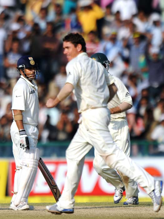 Marcus North celebrates the wicket of Sachin Tendulkar during the third day of the opening Test between India and Australia in Mohali. (AFP Photo)