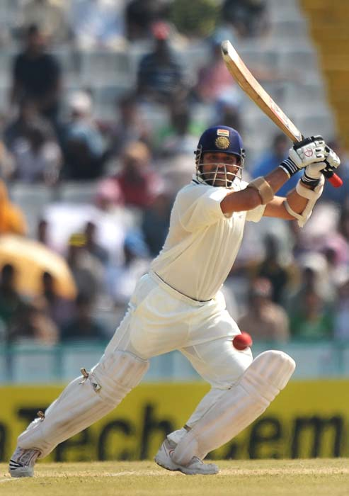 Sachin Tendulkar plays a shot during the third day of opening Test between India and Australia in Mohali. (AFP Photo)