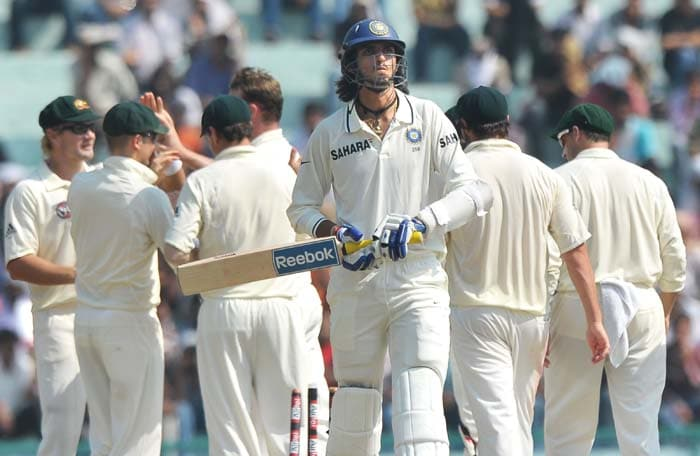 Ishant Sharma walks back to the dressing room after he was out as Australian cricketers celebrate his wicket during the third day of the opening Test between India and Australia in Mohali. (AFP Photo)
