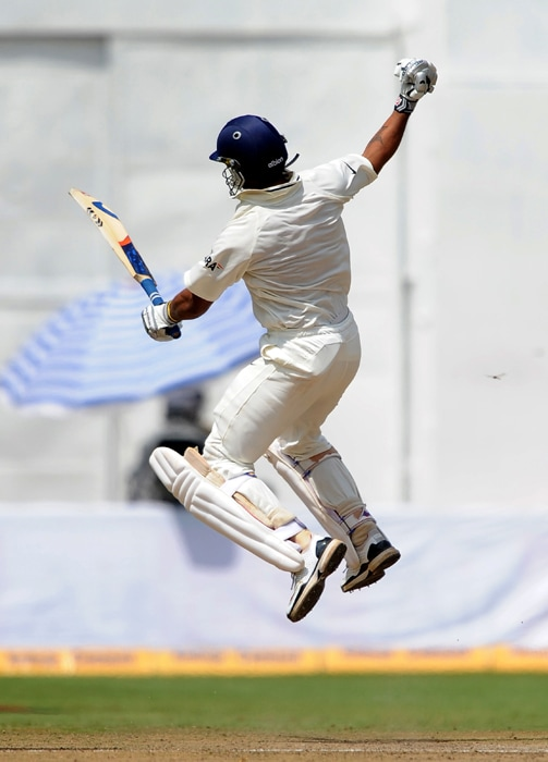 Murli Vijay jumps in the air as he celebrates his century during the third day of the second Test between India and Australia at M. Chinnaswamy Stadium in Bangalore. (AFP Photo)