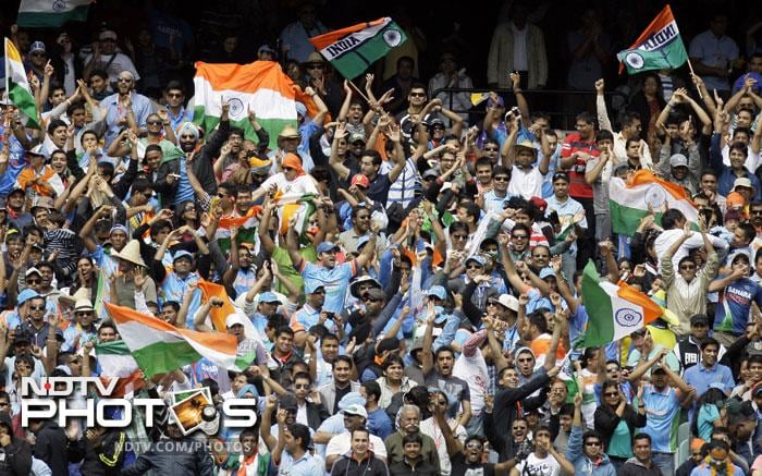 India fans cheer during the first Test match between India and Australia at the Melbourne Cricket Ground in Melbourne. (AP Photo)