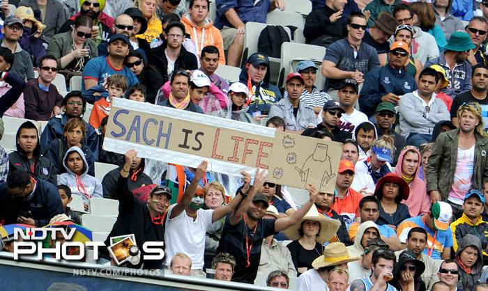 Indian fans hold up a banner on the first day of the first Test match between Australia and India at the Melbourne Cricket Ground in Melbourne. (AFP Photo)