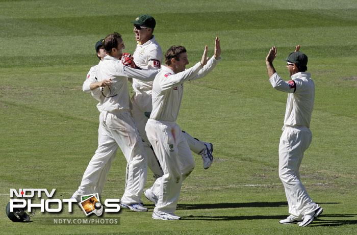 Australian players celebrate after defeating India on the fourth day of the first Test match at the Melbourne Cricket Ground in Melbourne. Australia won by 122 runs. (AP Photo)