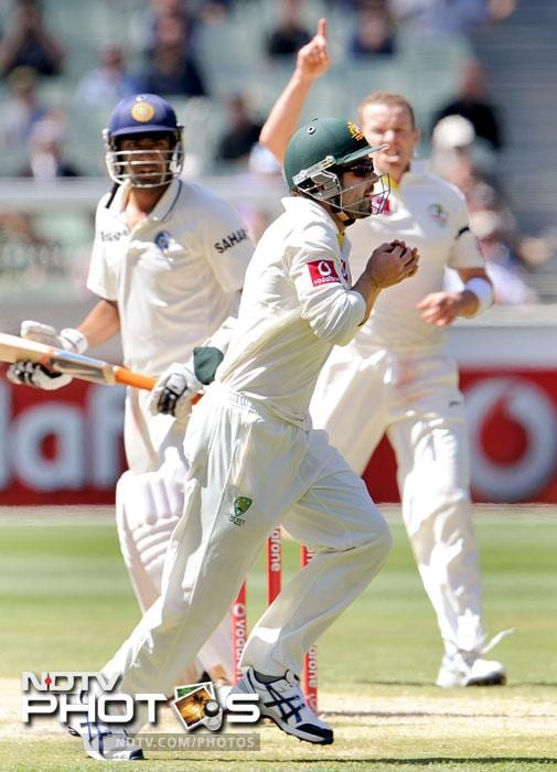 Ravichandran Ashwin is caught by Ed Cowan off Peter Siddle on the fourth day of the first Test match between Australia and India at the Melbourne Cricket Ground in Melbourne. (AFP Photo)