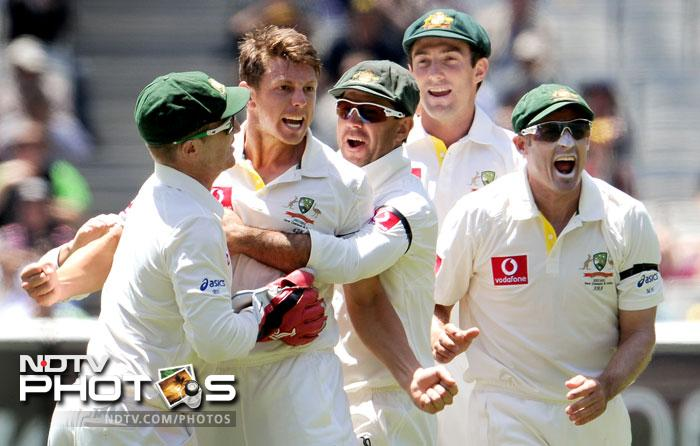 James Pattinson celebrates with teammates after dismissing Rahul Dravid on the fourth day of the first Test match between Australia and India at the Melbourne Cricket Ground in Melbourne. (AFP Photo)