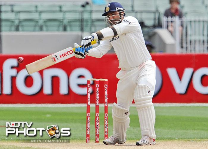 Virender Sehwag slashes at a ball from Ben Hilfenhaus on the fourth day of the first Test match between Australia and India at the Melbourne Cricket Ground in Melbourne. (AFP Photo)