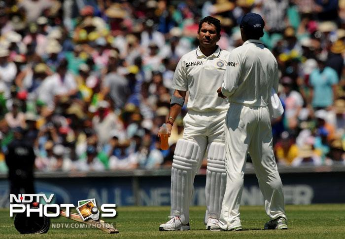 Sachin Tendulkar waits for new partner VVS Laxman to come out onto the ground on Day One of the second Test against Australia at the Sydney Cricket Ground. (AFP Photo)