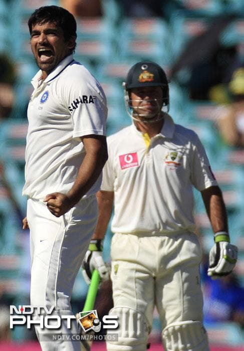 Zaheer Khan celebrates after taking the wicket of Ed Cowan for 16 runs as Ricky Ponting stands in his crease in their Test match at the Sydney Cricket Ground in Sydney. India made 191 in their first innings. (AP Photo)