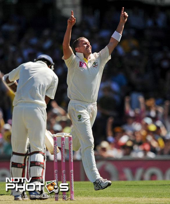 Peter Siddle celebrates after taking his 100th Test wicket, Umesh Yadav on Day One of the second Test at the Sydney Cricket Ground. (AFP Photo)