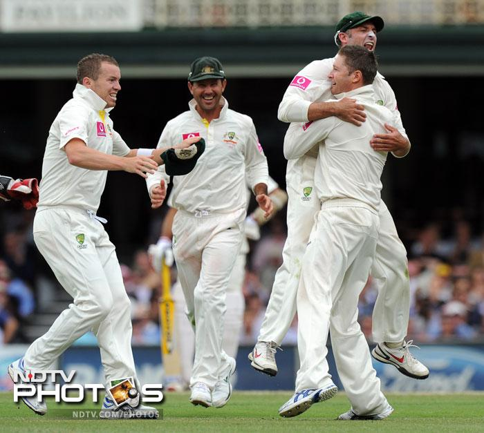 After catching Sachin Tendulkar for 80 at first slip, Mike Hussey leaps into the arms of Michael Clarke as teammates Peter Siddle and former captain Ricky Ponting join in the celebrations during the second Test against Australia and the 100th Test at the Sydney Ground. (AFP Photo)
