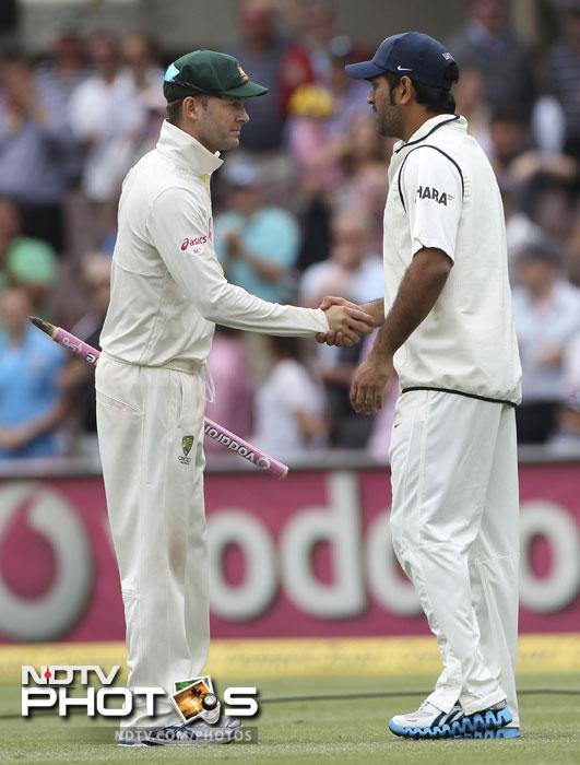 India skipper MS Dhoni congratulates Australia captain Michael Clarke after they won the second Test match at the Sydney Ground in Sydney. Australia beat India by an innings and 68 runs to storm home and take a 2-0 series lead. (AP Photo)
