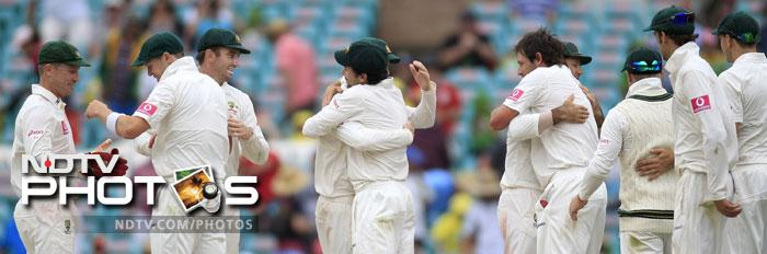 Australia players celebrate their win over India on the fourth day in their Test match at the Sydney Ground in Sydney. (AP Photo)